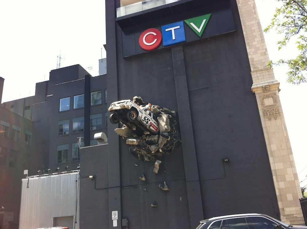 Sculpture on the side of a TV station building