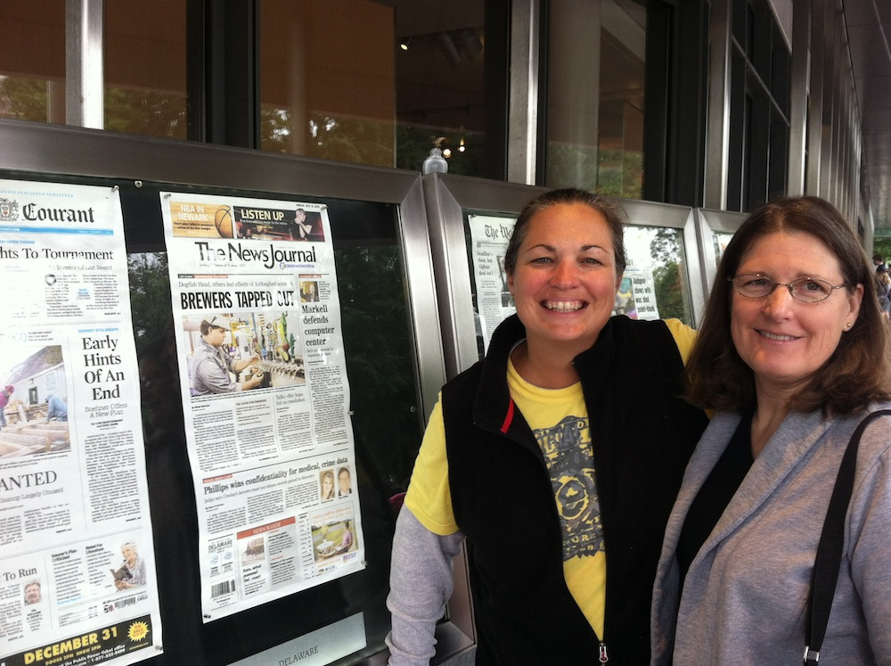 Me and Meg outside the Newseum in front of that day's headlines