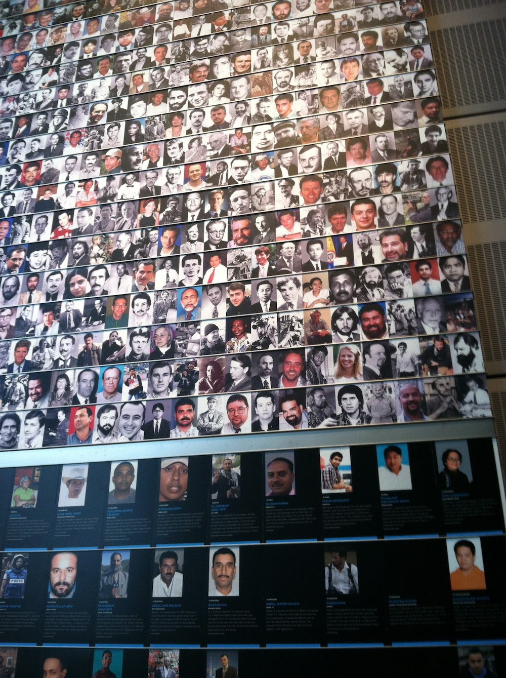 Memorial wall, photos of journalists who have died in pursuit of the story